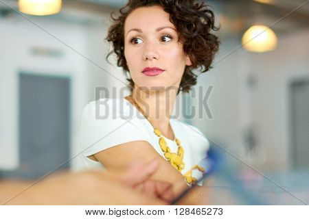 Portrait of casual female employee participating in a project during a team brainstorming