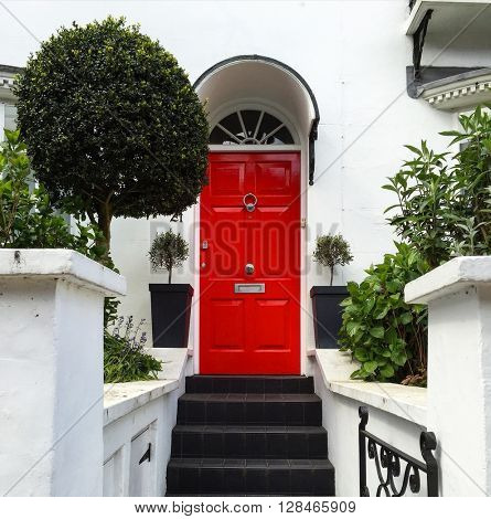LONDON - MAY 3: Smart house entrance with red front door on May 3, 2016 in Hampstead, London, UK.