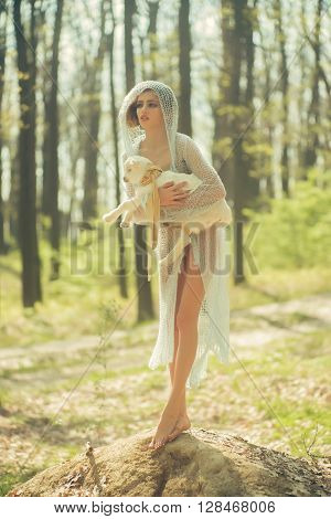 Young Woman With Goat In Forest