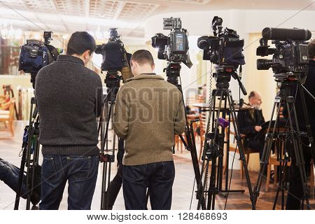 MOSCOW, RUSSIA - JAN 15, 2015: Cameramen before shooting interview in foyer of Moscow theatre Et Cetera after media preview of Boris Godunov directed by Peter Stein.