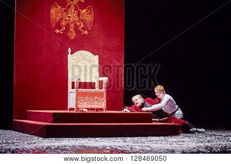 MOSCOW, RUSSIA - JAN 15, 2015: Dying Tzar Boris and his son Fyodor on stage of Moscow theatre Et Cetera in play Boris Godunov directed by Peter Stein.