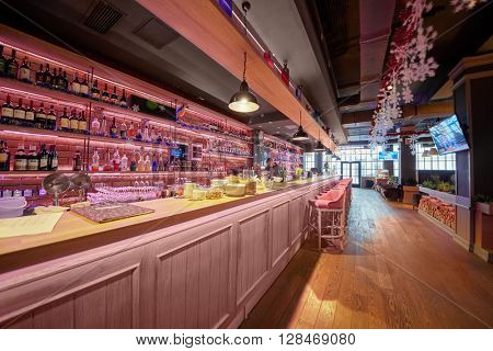 RUSSIA, MOSCOW - DEC 28, 2014: Barman at the bar counter in the restaurant Siren (Lilac), located in Sokolniki park at Pesochnaya alley.