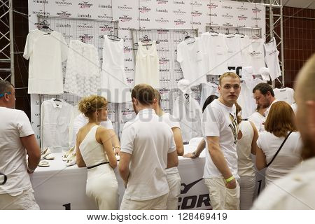 RUSSIA, MOSCOW - JUN 12, 2015: People in white at Lamoda shop in Olympiysky sports complex before Sensation Wicked Wonderland show begins.