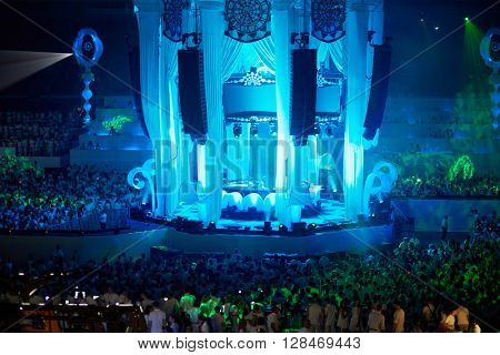 RUSSIA, MOSCOW - JUN 12, 2015: Central stage and dancing people on dance floor around and at grandstands during Sensation Wicked Wonderland show at Olympiysky sports complex.