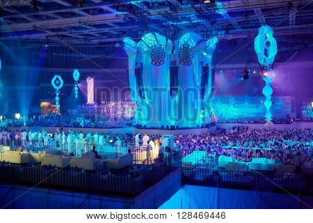RUSSIA, MOSCOW - JUN 12, 2015: People on dance floor and grandstands at Sensation Wicked Wonderland show  at Olympiysky sports complex.
