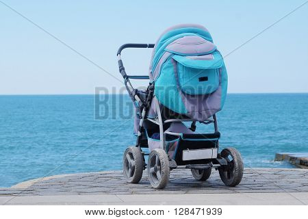 Perambulator on a sea beach