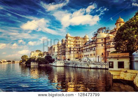 Romantic India luxury tourism wallpaper  - Vintage retro effect filtered hipster style image of Udaipur City Palace and Lake Pichola. Udaipur, Rajasthan, India