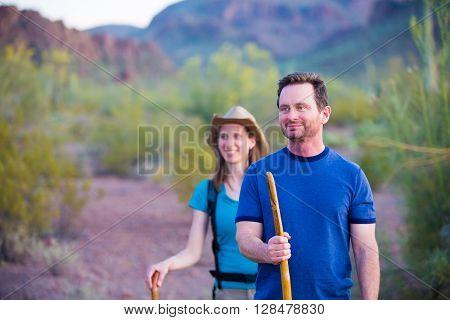 Desert Hikers On Mountain Path