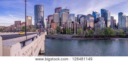 CALGARY, CANADA - MAY 1: Panorama of Calgary's skyline from the centre street bridge on May 1, 2016 in Calgary, Alberta. The famous Bow River is in the foreground.