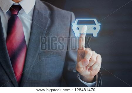 Businessman Pressing Car Icon In The Air With One Finger