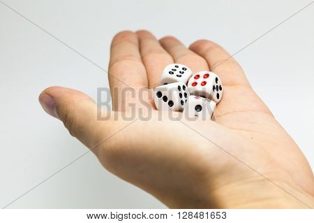Human Hand Ready To Roll The Dice On White Isolated Background - Try Luck, Take Risk Or Business Con