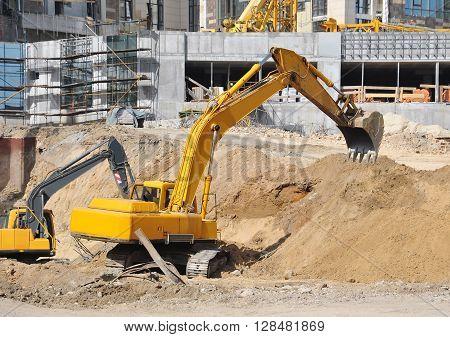Excavating Machine On Construction Site