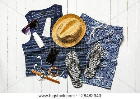 Summer holiday background Beach accessories on white wood board Vacation and travel items