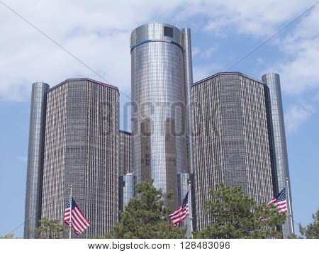 DETROIT, MICHIGAN - May 3, 2016. Three American flags fly in front of the towers of the landmark Renaissance Center, which is also known as the RenCen.