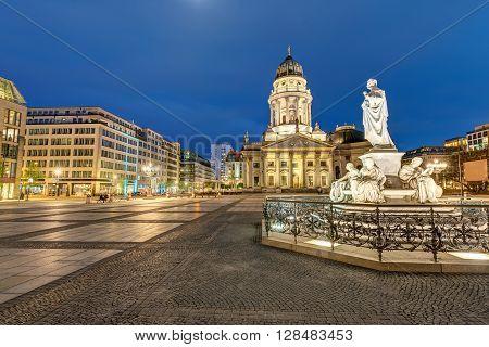 The beautiful Gendarmenmarkt with the statue of Schiller in Berlin at night