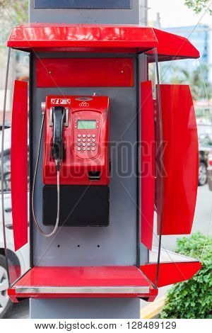 red payphone on a city street