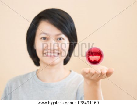 Red magic ball on asian woman hand stock photo