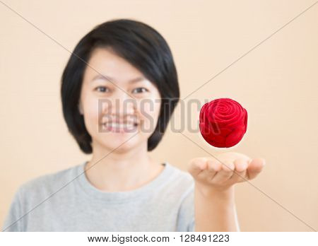 Red rose of ring box on woman hand stock photo