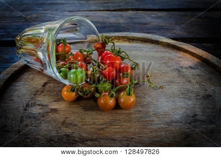 Round Wooden Plate With Tomatoes On Vintage Rustic Stylewooden Background