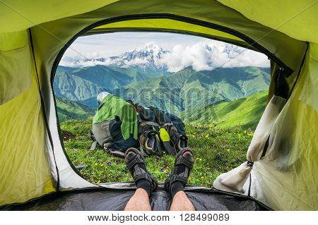 View from inside a tent on the snow-capped mountains in Georgia (Svaneti)
