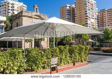Street cafe with sunshade at summer day