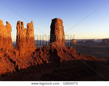 Tall rock formations in Monument National Park at sunset. Horizontal shot.
