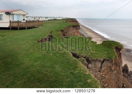 Clay cliffs eroding on the east coast of Yorkshire, UK.
