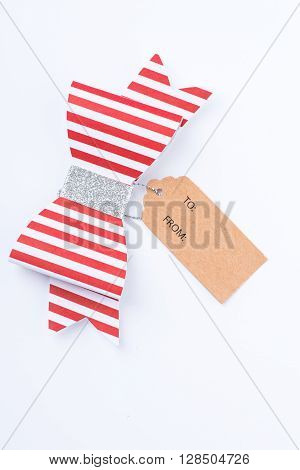Red Gift Bow With Stripes And Tag