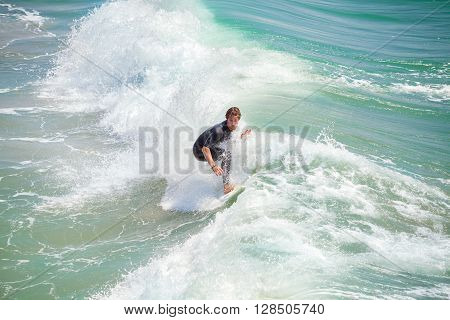 Venice Beach, Los Angeles, Usa - August 22, 2015: Surfer Riding Wave On A Beautiful Sunny Day.