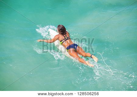 Venice Beach, Los Angeles, Usa - August 22, 2015: Woman Swimming On A Surfboard On A Beautiful Sunny