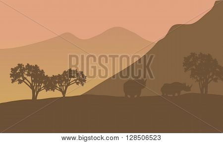 Rhino silhouette on the mountain a beautiful scenery