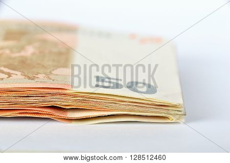 group of fifty euro banknotes with white background