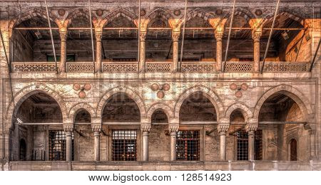 Side walls of Yeni Cami New Mosque in Istanbul, Turkey. The Yeni Cami (New Mosque), or Valide Sultan Mosque, commissioned by Sultan Safiye and designed by Davut Aga, on the Golden Horn, Istanbul, Turkey, 16th-17th century