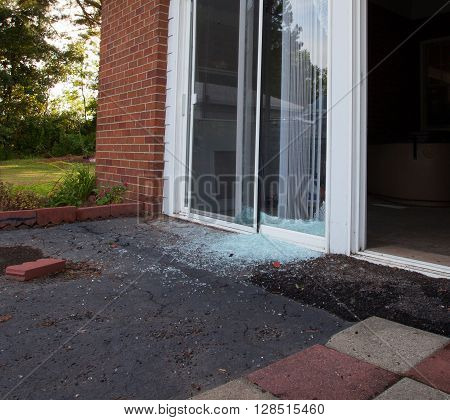 Shattered sliding glass window the morning after a home invasion
