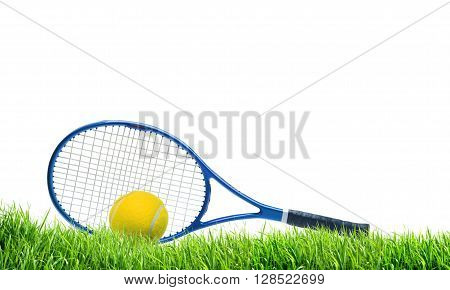 Blue tennis racket and yellow ball on green grass over white background