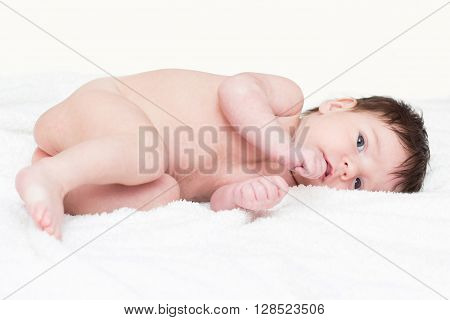 Cute baby on white towel after bath