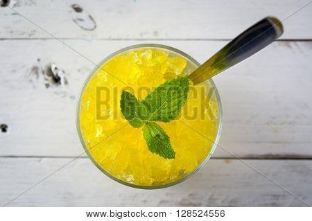 Fresh Lemon slushie in glass on white wood