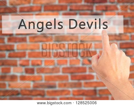Angels Devils - Hand Pressing A Button On Blurred Background Concept On Visual Screen.