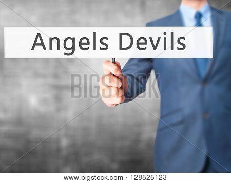 Angels Devils - Businessman Hand Holding Sign