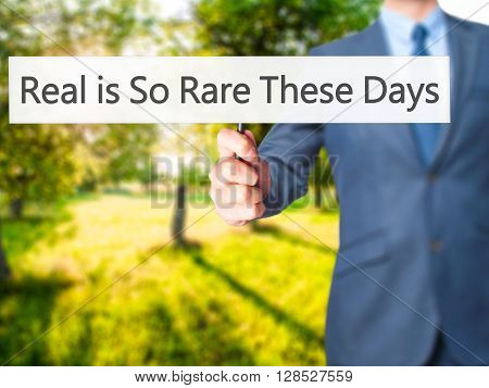 Real Is So Rare These Days - Businessman Hand Holding Sign