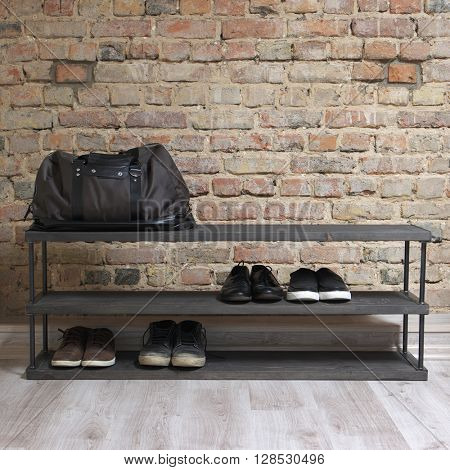 modern wooden shoe rack in the loft interior