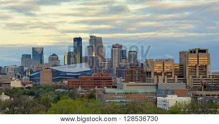 MINNEAPOLIS MN - APRIL 22 2016: Downtown Minneapolis Skyline with Minnesota Vikings US Bank Stadium and the University of Minnesota