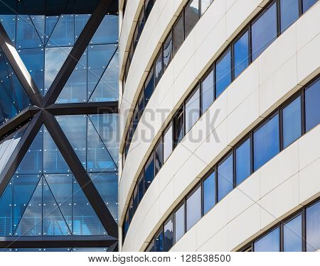 Abstract modern building. Close-up view of the modern building of steel and glass. Modern architecture.