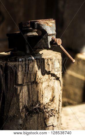 Metalworking hand tool on a tree stump.