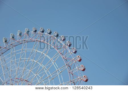Ferris wheel in a nice clear blue sky with space for text taken in Japan