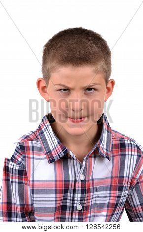 young boy making a mean face isolated on white background