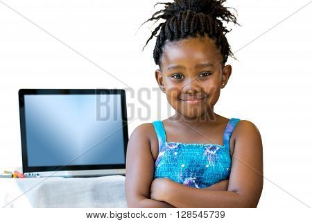 Close up portrait of little african kid standing with laptop in background.Isolated on white background.