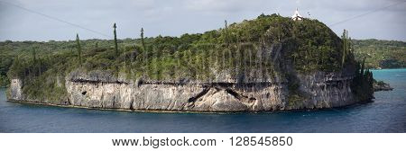 The panoramic view of coral made island Lifou with a church on a top of a hill (Easo New Caledonia).