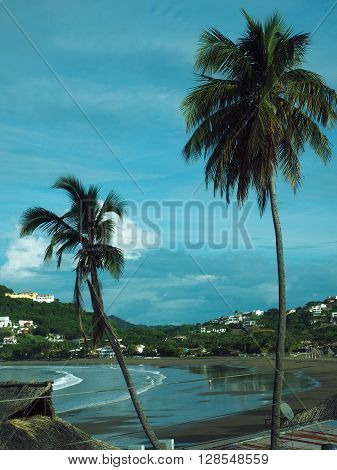 view over San Juan del Sur Bay beach with palm trees Nicaragua Pacific Ocean