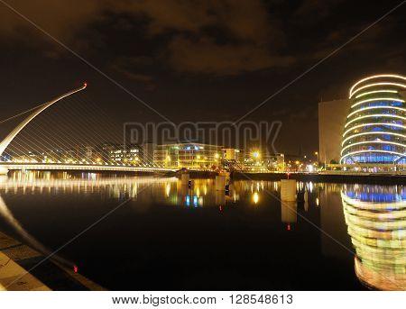 DUBLIN-SEPT. 21: Samuel Beckett Bridge is seen over River Liffy with modern Convention Center in Dublin Ireland Europe on September 21 2015.
